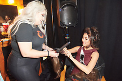December 8, 2019, Atlanta, Georgia, USA: Frederika Cull, Miss Indonesia 2019 gets hair done by a stylist from Farouk Systems, the Makers of CHI & Biosilk backstage during The Miss Universe Competition telecast, held at Tyler Perry Studios. Contestants from around the globe have spent the last few weeks touring, filming, rehearsing and preparing to compete for the Miss Universe crown. (Credit Image: © Benjamin Askinas/Miss Universe Organization via ZUMA Wire)
