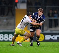 Bristol Rugby Hooker (#2) Rhys Lawrence is challenged by Leeds Carnegie Outside Centre (#13) Peter Lucock - Photo mandatory by-line: Dougie Allward/JMP - Tel: Mobile: 07966 386802 13/10/2013 - SPORT - FOOTBALL - RUGBY UNION - Memorial Stadium - Bristol - Bristol Rugby v Leeds Carnegie - B&I Cup
