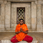 Priest in colourful robes at Jain temple at Ranakpur
