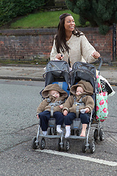 Mother crossing road with twins in buggy, (This photo has extra clearance covering Homelessness, Mental Health Issues, Bullying, Education and Exclusion, as well as the usual clearance for Fostering & Adoption and general Social Services contexts,)