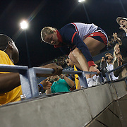 Kim Clijsters, Belgium, climbs down from the stands after winning the Women's Singles Final  against Caroline Wozniacki, Denmark at  the US Open Tennis Tournament at Flushing Meadows, New York, USA, on Sunday, September 13, 2009. Photo Tim Clayton.