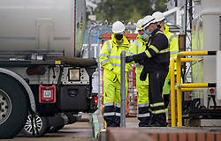 © Licensed to London News Pictures. 04/10/2021. London, UK. Members of the military are seen being given instructions on how to operate a fuel tanker at Buncefield oil depot in Hemel Hempstead, Hertfordshire. Military personnel are expected to start helping with driver shortages today following more than a week of long queues and closures at petrol stations. Photo credit: Ben Cawthra/LNP