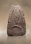 Late European Neolithic prehistoric Menhir standing stone with carvings on its face side. The representation of a stylalised male figure starts at the top with a long nose from which 2 eyebrows arch around the top of the stone. Excavated from Paule Luturru,  Samugheo. Menhir Museum, Museo della Statuaria Prehistorica in Sardegna, Museum of Prehoistoric Sardinian Statues, Palazzo Aymerich, Laconi, Sardinia, Italy. Warm art background.<br /> <br /> Visit our PREHISTORIC PLACES PHOTO COLLECTIONS for more  photos to download or buy as prints https://funkystock.photoshelter.com/gallery-collection/Prehistoric-Neolithic-Sites-Art-Artefacts-Pictures-Photos/C0000tfxw63zrUT4