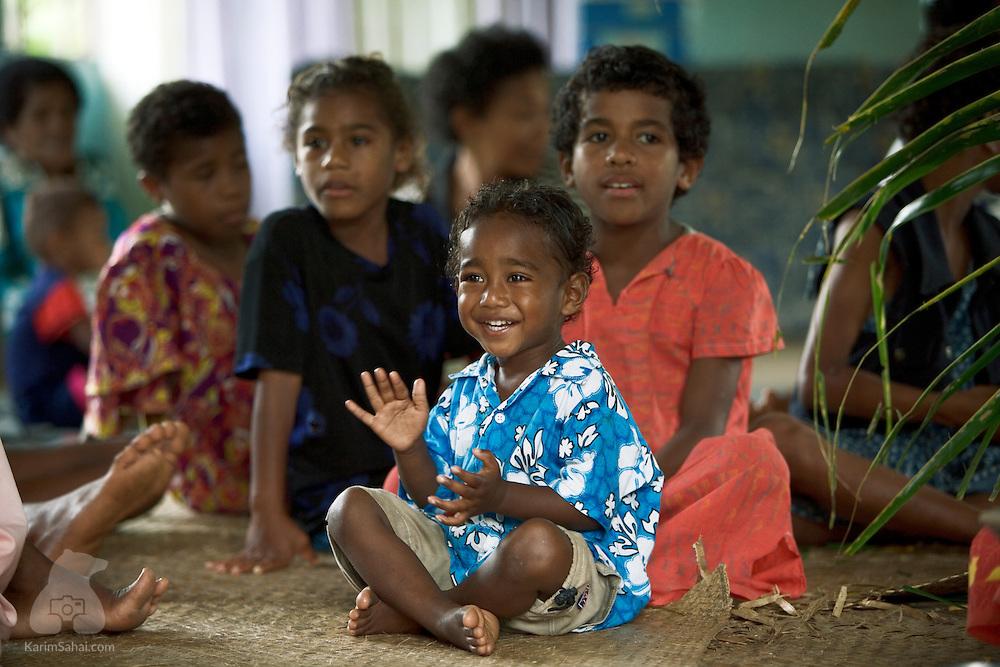Children at a nakamal (communal house), Nukubulavu, Kadavu island, Fiji.<br /> <br /> Kadavu is the fourth largest island in the fijian archipelago and is home to about 10,000 people.