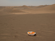 A lunch break of oranges in the middle of the desert.