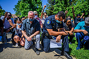 Sacramento Police Chief Daniel Hahn and Mayor Darrell Steinberg kneel with a large group of demonstrators in Sacramento's Oak Park  neighborhood on Wednesday, June 3, 2020, in a display of unity as another day of protests over the death of George Floyd was planned in the capital.