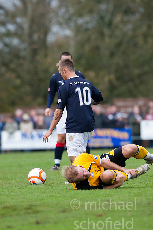 Falkirk's Kallum Higginbotham tackles Annan Athletic's Bryan Gilfillan and gets booked..Annan Athletic 0 v 3 Falkirk. Semi Final of the Ramsdens Cup, 9/10/2011..Pic © Michael Schofield.