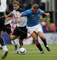 Fotball<br /> Treningskamp England<br /> <br /> Foto: Frances Leader, Digitalsport<br /> NORWAY ONLY<br /> <br /> Fulham v Rangers<br /> Pre-season friendly<br /> 24/08/2004.<br /> <br /> Fulham's Moritz Volz colides with Rangers Peter Lövenkrands