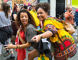 London, August 30th 2015. Revellers enjoy day one of the Notting Hill Carnival.