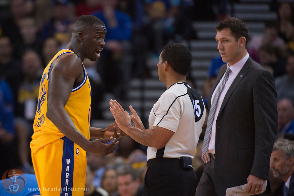 November 17, 2015; Oakland, CA, USA; Golden State Warriors forward Draymond Green (23, left) argues with NBA referee Bill Kennedy (55, center) as Warriors interim head coach Luke Walton (right) looks on during the third quarter against the Toronto Raptors at Oracle Arena. The Warriors defeated the Raptors 115-110.