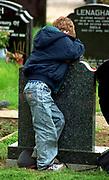 Northern Ireland Belfast children harass a British soldier on patrol.