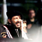 Lawrence J. Simpson, Senior VP Academic Affairs and songwriter Juan Luis Guerra smiling at Berklee Collage Commencement, 2009