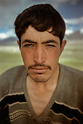 Dost Mohammed, a Wakhi from Sarhad at Andemin winter camp. Each summer, quite a few Wakhis walk to the Little Pamir to look for work. A lot of them are unsuccessful. These ones were eventually hired by Kyrgyz for their skills at building mud and stone walls. They build winter house and corrals to keep the livestock at night.<br /> <br /> Adventure through the Afghan Pamir mountains, among the Afghan Kyrgyz and into Pakistan's Karakoram mountains. July/August 2005. Afghanistan / Pakistan.