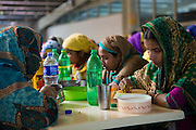 Garment workers having their lunch in the canteen at Epyllion Group garment factory in Bangladesh. <br /> <br /> Workers get an hour for their lunch break.