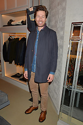 Racing driver SAM HANCOCK at the launch of the Private White VC flagship store, 73 Duke Street, London on 11th December 2014.