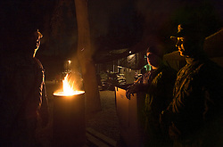 Soldiers with the 1st Infantry, 17th Regiment, keep warm at night by a bonfire, Mosul, Iraq, Dec. 16, 2005. The troops were helping Iraqi forces secure the area in preparation for Iraq's first post-Saddam parliamentary elections. The western sector is home to Mosul's primarily Sunni population, which has been resistant to the American presence in Iraq.
