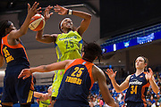 Glory Johnson of the Dallas Wings drives to the basket against the Connecticut Sun during a WNBA preseason game in Arlington, Texas on May 8, 2016.  (Cooper Neill for The New York Times)
