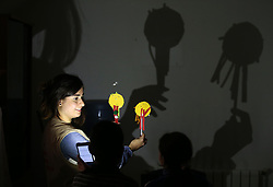 Psychologist Lina Zaarour running a puppet-making workshop during an art therapy class for Syrian refugee children at a Caritas centre in the Bekaa Valley region of Lebanon. The classes form part of the psychological care given to the children to help them overcome the trauma of war using arts, crafts and games.