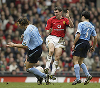 Photo. Aidan Ellis.<br /> Manchester United v Manchester City.<br /> FA Cup Fifth Round.<br /> 14/02/2004.<br /> United's Roy Keane and City's Daniel Van Buyten and Claudio Reyna