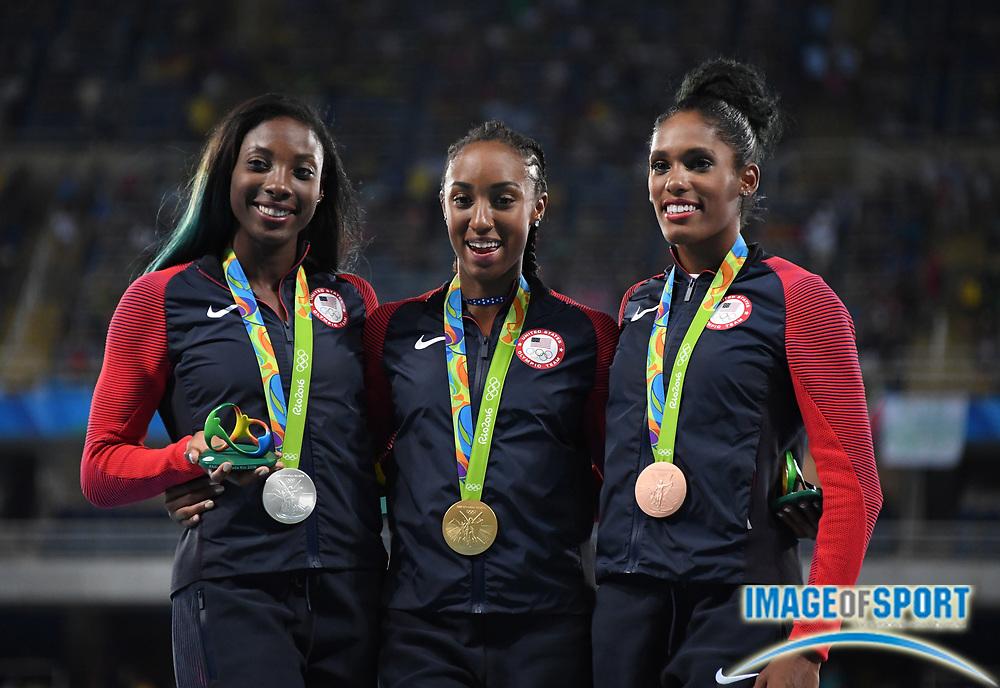 Aug 18, 2016; Rio de Janeiro, Brazil; Women's 100m hurdles gold medalist Brianna Rollins (USA), center, poses with silver medalist Nia Ali (USA), left, and bronze medalist Kristi Castlin (USA) during the 2016 Rio Olympics at Estadio Olimpico Joao Havelange.