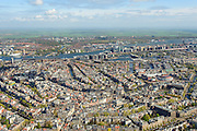 Nederland, Noord-Holland, Amsterdam, 09-04-2014; binnenstad en grachtengordel, overzicht vanuit het zuiden. Amsterdam-Noord aan de horizon. <br /> Te zien zijn onder andere: het Paleis op de Dam, Centraal station, het IJ, Filmmuseum Eye, Java-eiland, Oosterdokseiland, het platteland van Waterland.<br /> Center and ring of canals of Amsterdam, seen from the south. Top pic: Amsterdam-Noord (north) on the horizon en newly constructed residential districts on the isles.<br /> luchtfoto (toeslag op standard tarieven);<br /> aerial photo (additional fee required);<br /> copyright foto/photo Siebe Swart