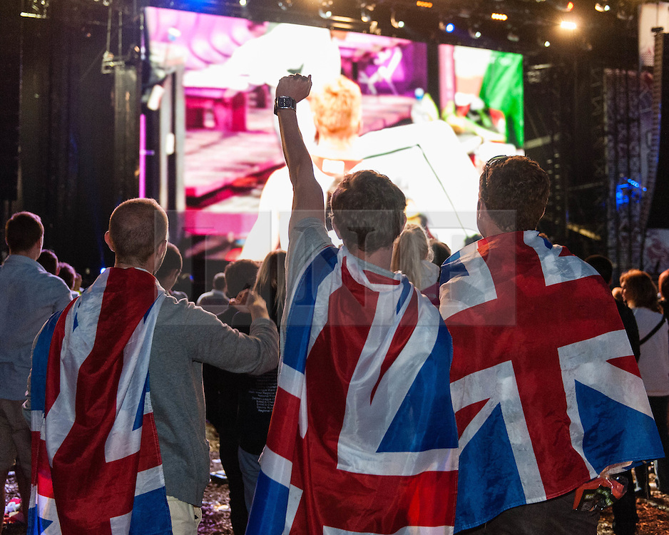 © Licensed to London News Pictures. 04/08/2012. London, UK.   Crowd celebrations at BT London Live, Hyde Park, as Greg Rutherford wins Gold medal in the Olympic Long Jump for Team GB.  Photo credit : Richard Isaac/LNP