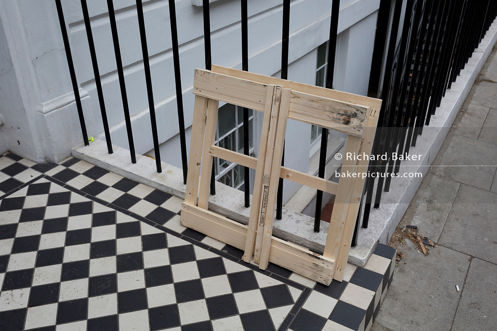 The geometric repetition of squares and confusion of angles, at the entrance of a property in Fitzrovia, on 16th January 2019, in London, England.