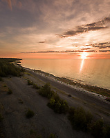Panoramic aerial view of the Estonian coastline at sunset on Vormsi island.