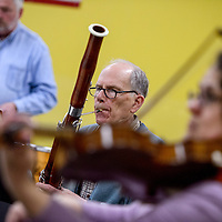 John Mezoff play the bassoon with the Red Rock String Ensemble during rehearsal at Miyamura High School in Gallup Sunday.