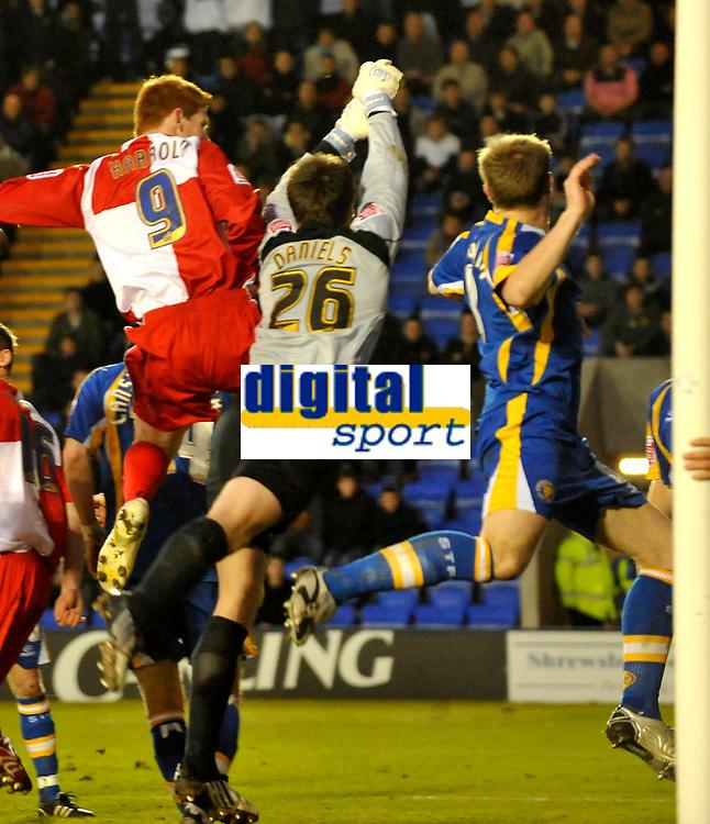 Photo: Paul Greenwood/Richard Lane Photography. Shrewbury Town v Wycombe Wanderers. Coca Cola Two. 20/12/2008. <br />Wycombe's Matt Harrold (9) beats Shrewsbury keeper Luke Daniels in the air to score