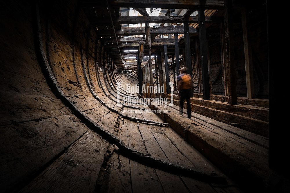 A man walks through the worn cargo hold of the historic merchant ship, the Edwin Fox, in Picton, New Zealand.
