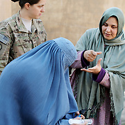 Women in burqas learn how to clean and back-flush water filters with the Female Engagement Team (FET) with a translator in a water filtration demonstration in the village of Nari, Kunar Province of Eastern Afghanistan with Waves For Water and the US Military.