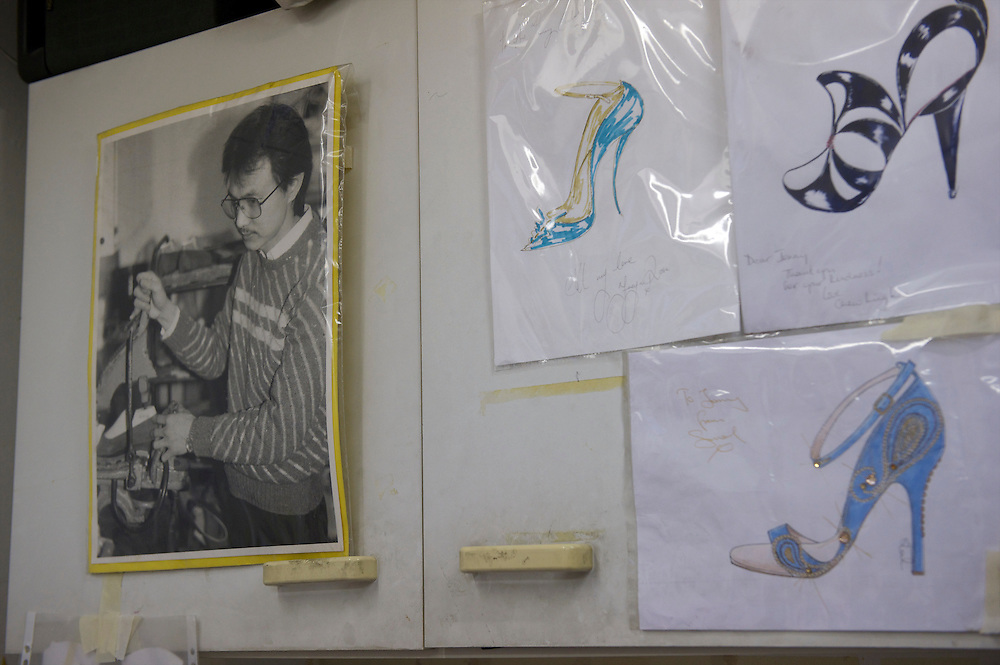 A 1980s photograph of fashion designer Jimmy Choo is displayed on the wall of his studio on Cannaught Street, London, March 22, 2010.