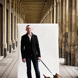 "Julien Brunel like to walk across the streets of Paris along with his dog, Russel. ""Paris walkers"", for Eurostar Magazine. Paris, France. 18 March 2010. Photo: Antoine Doyen."