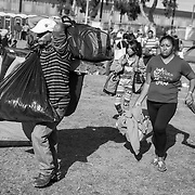 Migrants fleeing Central America and parts of Southern Mexico traveled nearly a month before arriving in Tijuana, Mexico where they were placed in shelters. The migrants planned to ask for asylum while presenting themselves to authorities at the US Port of Entry at San Ysidro, CA.