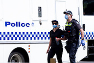 MELBOURNE, VIC - SEPTEMBER 19: A demonstrator is detained by Victoria Police during the Freedom protest on September 19, 2020 in Melbourne, Australia. Freedom protests are being held in Melbourne every Saturday and Sunday in response to the governments COVID-19 restrictions and continuing removal of liberties despite new cases being on the decline. Victoria recorded a further 21 new cases overnight along with 7 deaths. (Photo by Mikko Robles/Speed Media)