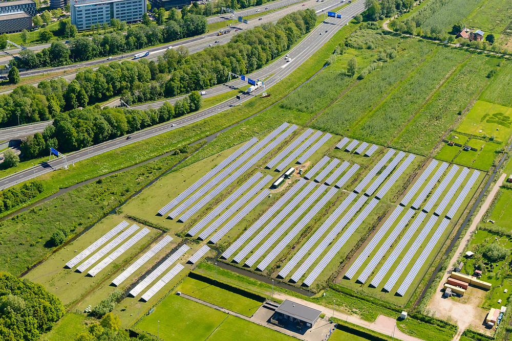 Nederland, Utrecht, Nieuwegein, 13-05-2019; Solarpark Galecop in de groenstrook aan de Galecopperzoom, parallel aan de A12 bij Oudenrijn.<br /> Solar park near highway A12, south of Utrecht.<br /> <br /> luchtfoto (toeslag op standard tarieven);<br /> aerial photo (additional fee required);<br /> copyright foto/photo Siebe Swart