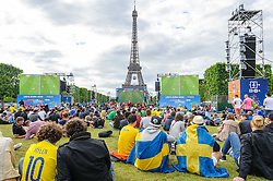 Fans look towards the Eiffel Tower while watching Austria v Hungary on the big screens at the Paris fanzone. Images from the UEFA EURO 2016, 14 June 2016 in Fan Zone. (c) Paul Roberts   Edinburgh Elite media. All Rights Reserved