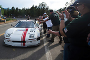 June 30, 2013 - Pikes Peak, Colorado.  James<br /> Robinson celebrates with fans after the 91st running of the Pikes Peak Hill Climb.