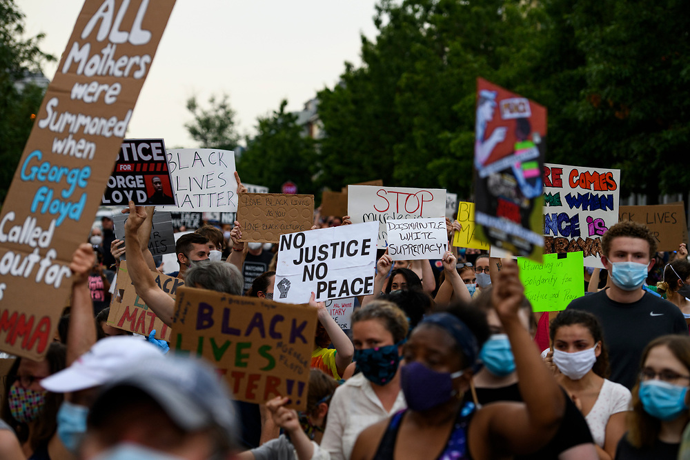 More than 2000 people gather at the Charles Houston Recreation Center in Alexandria, VA to protest the killing of George Floyd in police custody.