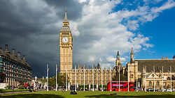 Big Ben and House of Commons with Red bus, London, England, UK. 12/05/14. Photo by Andrew Tallon