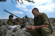 IDF artillery officer checking out his soldiers. 2nd Lebanon War. Israel, August 2006.