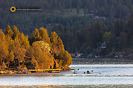 Pair of sea kayakers in days last light on Flathead Lake in Somers, Montana, USA