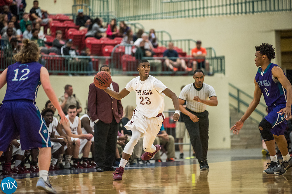 Jay M. Robinson's Lavar Batts Jr. (23) brings the ball down against Cox Mill during the NCHSAA 3A regional semi-finals at the Cabarrus Arena & Event Center in Concord Tuesday night. Robinson won the game 80-69 to advance to the regional finals.