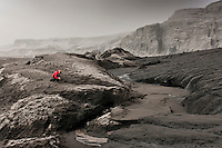 Ash covers the ground at Solheimajokull Glacier.