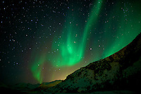 Northern Lights and Powerline on Kvaløya (Whale) island in Norway. Image taken with a Nikon D800 and 24 mm f/1.4G flens (ISO 800, 24 mm, f/1.4, 8 sec)..
