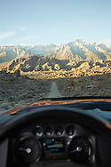 Point of view as driving a rural road on the eastern slope of the Sierra Nevada Mountains as seen from the Alabama Hills of California.