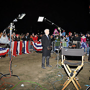 Crowd watch as CNN's Anderson Cooper broadcasts on location from the National mall on the eve of Obama's Inauguration.