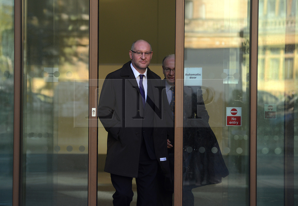 © Licensed to London News Pictures.15/11/2013. London, UK. Nick Parker, Sun journalist leaves the Westminster Magistrates' Court where he faces charges linked to the alleged theft of a mobile belonging to MP Siobhain McDonagh. Parker is accused of one count of receiving stolen goods and one of unauthorised access to computer material.Photo credit : Peter Kollanyi/LNP