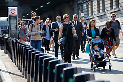 © Licensed to London News Pictures. 09/07/2015. London, UK. Commuters walking past an empty Boris bike station outside Waterloo Station as tube strike shuts down the entire London Underground network on Thursday, July 9, 2015. The strike called by RMT, TSSA and Unite unions is a 27-hour stoppage by about 20,000 Tube staff and shuts down the entire London Underground network. Photo credit: Tolga Akmen/LNP